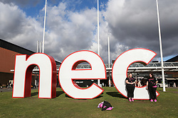 © Licensed to London News Pictures. 09/03/2017. Birmingham, UK. Two Collies and a Spaniel sit atop the giant NEC sign with their owners at the 126th annual Crufts dog show at the NEC in Birmingham, West Midlands. The show is organised by the Kennel Club and is the biggest of it's kind in the world.  Photo credit : Ian Hinchliffe/LNP