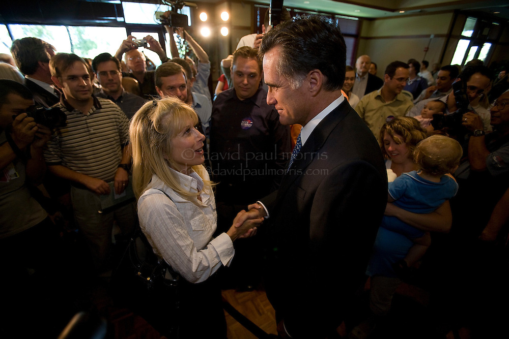 """SANTA CLARA, CA - SEPTEMBER 24:   Republican presidential candidate Mitt Romney takes part in a town hall meeting """"Ask Mitt Anything""""  September 24, 2007 in Santa Clara, California.  Romney, who has been on a campaign stops in California, seems to be distancing himself more and more lately from the current administration suggesting recently that the Republican Party had gone off course during the presidency of President George Bush and when the Republicans controlled the Congress.  (Photo by David Paul Morris)"""