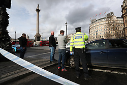 Police in Trafalgar Square, London, after policeman has been stabbed and his apparent attacker shot by officers in a major security incident at the Houses of Parliament.