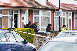 People who appear to be detectives leave a house in Chalgrove Road, Tottenham, North London, opposite the scene where a seventeen year-old girl was shot dead on the evening of April 2nd. London, April 03 2018.