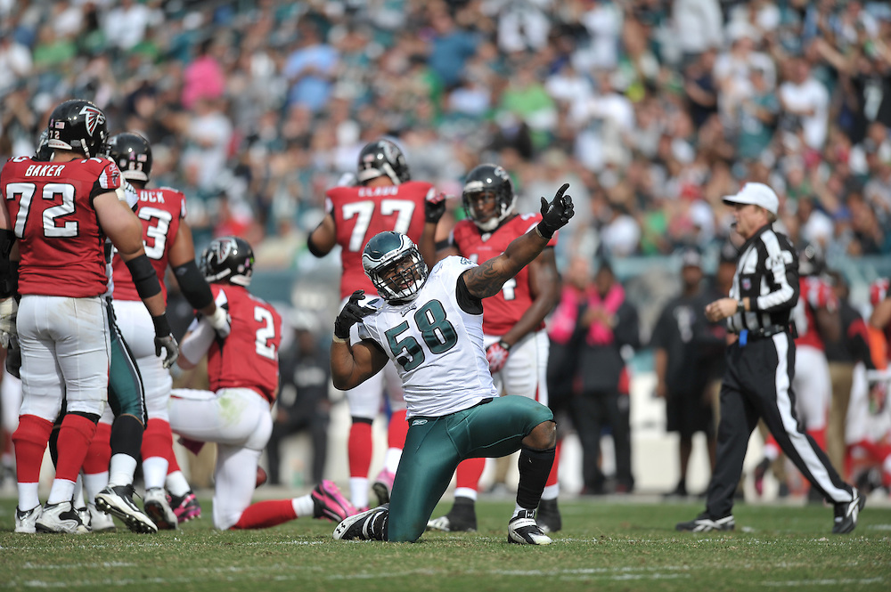 PHILADELPHIA - OCTOBER 17: Defensive end Trent Cole #58 of the Philadelphia Eagles celebrates during the game against the Atlanta Falcons at Lincoln Financial Field on October 17, 2010 in Philadelphia, Pennsylvania. The Eagles won 31-17. (Photo by Drew Hallowell/Getty Images)  *** Local Caption *** Trent Cole
