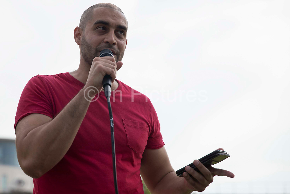 Rapper Lowkey addresses human rights activists outside ExCeL London as preparations take place for the DSEI 2021 arms fair on 6th September 2021 in London, United Kingdom. The first day of week-long Stop The Arms Fair protests outside the venue for one of the worlds largest arms fairs was hosted by activists calling for a ban on UK arms exports to Israel.