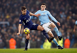 Tottenham Hotspur's Harry Winks (left) and Manchester City's Phil Foden battle for the ball