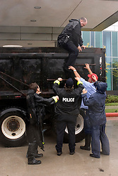 24 Sept, 2005. Beaumont, Texas. Hurricane Rita. <br /> <br /> Police unload search and rescue colleagues at the St Elizabeth's hospital after checking neighbourhoods for possible storm victims who may have needed rescuing or evacuating.<br /> Photo; ©Charlie Varley/varleypix.com