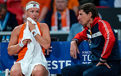 Kiki Bertens discuss with Coach Paul Haarhuis in the Fed Cup qualifier against Belarus in Sportcampus Zuiderpark, The Hague, Netherlands