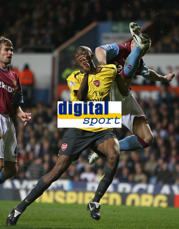 Photo: Rich Eaton.<br /> <br /> Aston Villa v Arsenal. The Barclays Premiership. 14/03/2007. Phil Bardsley clears from Arsenals Abou Diaby left