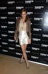TARA PALMER-TOMKINSON at a party to launch Three's A Crowd held at the Mayfair Hotel, Berkley Street, London on 5th December 2006.<br />