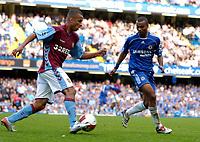 Photo: Daniel Hambury.<br />Chelsea v Aston Villa. The Barclays Premiership. 30/09/2006.<br />Chelsea's Ashley Cole and Villa's Gabriel Agbonlahor battle.