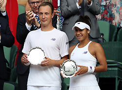 Heather Watson and Henri Kontinen with their runner up trophy following defeat to Martina Hingis and Jamie Murray in the mixed doubles final on day thirteen of the Wimbledon Championships at The All England Lawn Tennis and Croquet Club, Wimbledon.