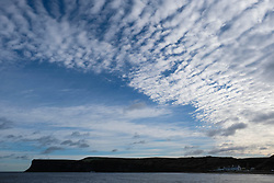 © Licensed to London News Pictures. <br /> 10/01/2017. <br /> Saltburn by the Sea, UK.  <br /> <br /> Altocumulus Undulatus cloud formations form in the sky over Huntcliff in Saltburn by the Sea.<br /> <br /> The wave like pattern is caused by the way the winds vary with altitude and blow at different speeds above and below the cloud layer.<br /> <br /> <br /> Photo credit: Ian Forsyth/LNP