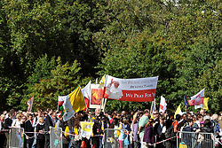 CENTRAL LONDON.  Pilgrims waiting to gain entry to the vigil. Crowds of Londoners, visitors and pilgrims visit Hyde Park,London, for the visit of Pope Benedict XVI on 17/18th September 2010. It is estimated that 80,000 people will flock to see the Pontiff during his visit to the capital. 18th September 2010.STEPHEN SIMPSON.