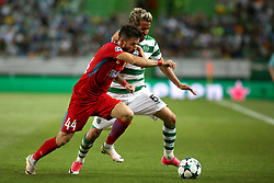 August 15, 2017 - Lisbon, Portugal - Sporting's defender Fabio Coentrao from Portugal vies with Steaua's midfielder Gabriel Enache (L) during the UEFA Champions League play-offs first leg football match between Sporting CP and FC Steaua Bucuresti at the Alvalade stadium in Lisbon, Portugal on August 15, 2017. Photo: Pedro Fiuza (Credit Image: © Pedro Fiuza via ZUMA Wire)