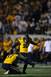 California kicker Dario Longhetto (30) kicks the extra point out of the hold of Jamieson Sheahan (37) during the first quarter of an NCAA college football game against Nevada, Saturday, Sept. 4, 2021, in Berkeley, Calif. (AP Photo/D. Ross Cameron)