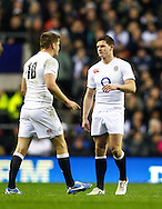 Picture by Andrew Tobin/SLIK images +44 7710 761829. 2nd December 2012. Owen Farrell (L) has a chat with Freddie Burns (R) as Farrell is substituted during the QBE Internationals match between England and the New Zealand All Blacks at Twickenham Stadium, London, England. England won the game 38-21.