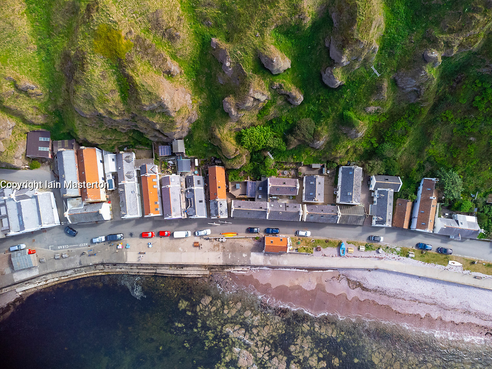 Aerial view from drone of houses in village of Pennan on Moray Firth coast in Aberdeenshire, Scotland, UK