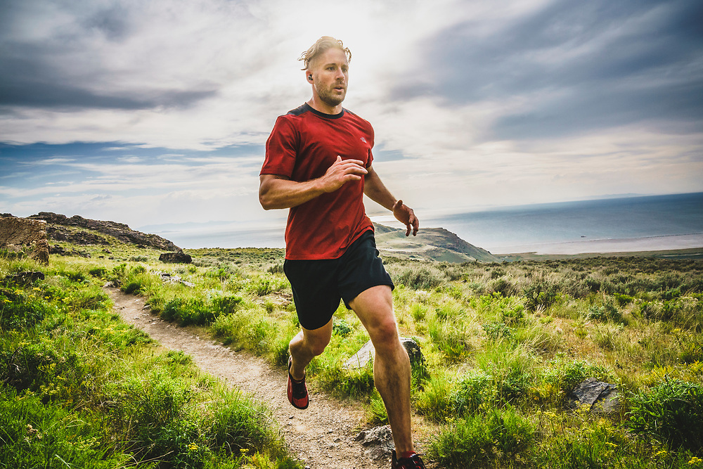 Robert Hunter running down from the summit of Frary Peak, Antelope Island, Great Salt Lake City, Utah.