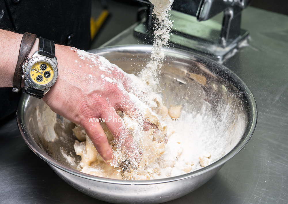 Making Tortellini pasta mixing flour and egg