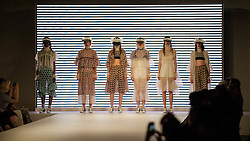 © Licensed to London News Pictures. 05/06/2016. London, UK. Models present looks by Nadia Sultana, from the University of East London. Graduate Fashion Week opens at the Old Truman Brewery in East London showcasing the work of over 1,000 of the very best graduates from over 40 universities around the world.  30,000 guests are expected to attend the annual event which features 22 catwalk shows and more. Photo credit : Stephen Chung/LNP