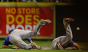 May 23, 2012; Houston, TX, USA; Chicago Cubs right fielder David DeJesus (9) and second baseman Darwin Barney (15) collide against the Houston Astros during the fourth inning at Minute Maid Park. Mandatory Credit: Thomas Campbell-US PRESSWIRE