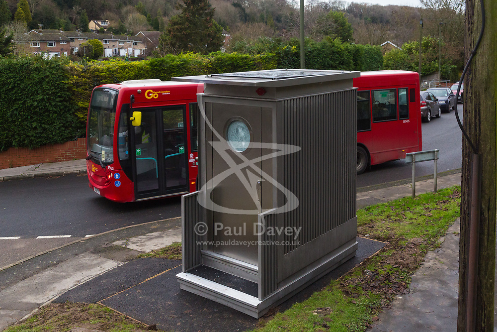 An R2 bus passes the toilet on its half-hour run to and from Orpington. Local residents are both mystified and annoyed about the sudden appearance of a toilet for bus drivers that has been erected on the corner of Melody Road and Whitby Close in Biggin Hill, Kent. Biggin Hill, Kent, December 06 2018.