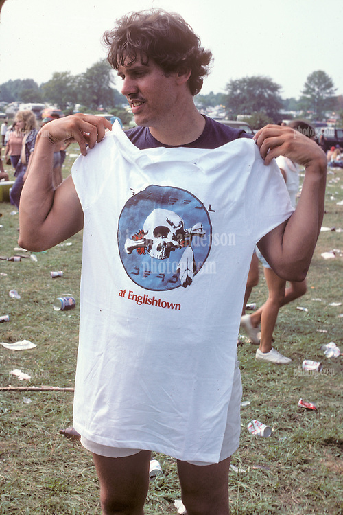 T-Shirt Man trying to sell to us Deadheads and Friends of Mine on our way into The Grateful Dead Concert at Raceway Park, Englishtown NJ on 3 September 1977. Labor Day Weekend and on The Road into the Show.