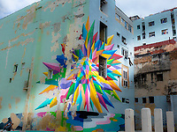 Large colourful painting of colour points on the exterior, wall of a building in Havana.
