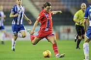 Bradley Dack (Gillingham) takes a shot during the Sky Bet League 1 match between Wigan Athletic and Gillingham at the DW Stadium, Wigan, England on 7 January 2016. Photo by Mark P Doherty.