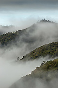 Clouds breaking in the mountains, Tomba Region, Mount Hagen, Western Highlands Province, Papua New Guinea