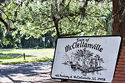 Sign marking the tiny hamlet of McClellanville, South Carolina. McClellanville is a tiny fishing village inside the Cape Romain National Wildlife Refuge and surrounded by Francis Marion National Forest.