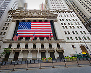 "The New York Stock Exchange (abbreviated as NYSE and nicknamed ""The Big Board""), is an American stock exchange located at 11 Wall Street, Lower Manhattan, New York City, New York. It is by far the world's largest stock exchange by market capitalization of its listed companies at US$19.69 trillion as of May 2015. The average daily trading value was approximately US$169 billion in 2013. The NYSE trading floor is located at 11 Wall Street and is composed of 21 rooms used for the facilitation of trading. A fifth trading room, located at 30 Broad Street, was closed in February 2007. The main building and the 11 Wall Street building were designated National Historic Landmarks in 1978."