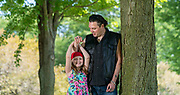 Joshua Crouse who is facing eviction from his home, stands with his 10-year-old daughter, Marley, in a park near their apartment in Janesville. (Photo © Andy Manis)