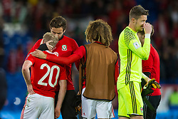 CARDIFF, WALES - Monday, October 9, 2017: Wales' goalkeeper Danny Ward consoles Jonathan Williams after the final whistle in the 2018 FIFA World Cup Qualifying Group D match between Wales and Republic of Ireland at the Cardiff City Stadium. (Pic by Paul Greenwood/Propaganda)