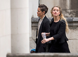 © Licensed to London News Pictures. 23/07/2020. London, UK. American actress AMBER HEARD (right) arrives at the High Court in London with her partner BIANCA BUTTI (left), where Johnny Depp is in a legal dispute with UK tabloid newspaper The Sun over allegations he assaulted his former wife, Amber Heard. Photo credit: Ben Cawthra/LNP