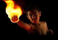 Martial artist boy with flame on hios fist. (Wilfredo Garcia / FGPhotoAgency)