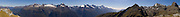 Snowy peaks rise high above Hollyford Valley in Fiordland National Park, as seen from atop Conical Hill, on the Routeburn Track, South Island, New Zealand. Panorama stitched from 14 overlapping photos.