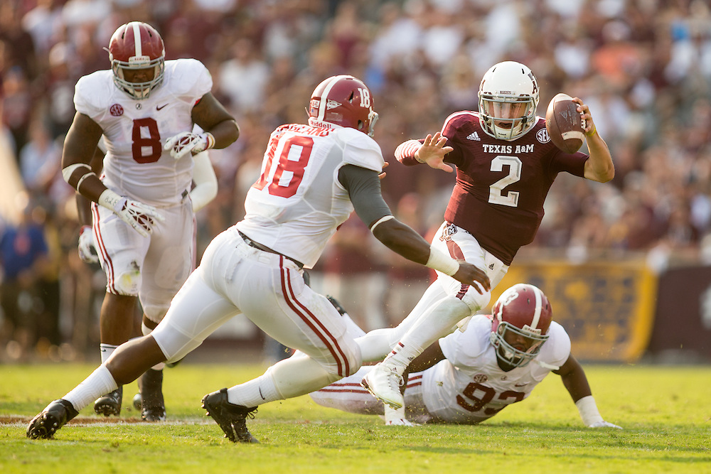 Texas A&M quarterback Johnny Manziel eludes the Alabama defense during a game at Kyle Field in College Station, Texas.
