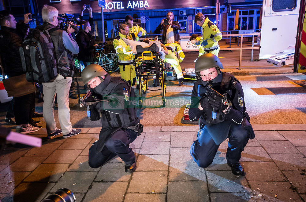 April 18, 2018 - Munich, Bavaria, Germany - During the night of April 17-18, the Munich Hauptbahnhof (train station) was closed for a large counter-terrorism training exercise, complete with the discharge of firearms, pursuits of suspects, and explosions.  The main exercise began at midnight and proceeded until 4am and was designed to simulate a terrorist commando unit attacking the Munich Central Station (Hauptbahnhof), which the anti-terrorism units were instructed to neutralize.  (Credit Image: © Sachelle Babbar via ZUMA Wire)
