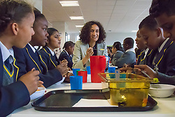 Michaela Community School, Wembley, London, June 23rd 2015. Mayor of London Boris Johnson visits the Michaela Community School, a Free School in Wembley that started taking students in September2014 after battling a certain amount of resistance from locals and unions. During the visit Head Teacher Katharine Birbalsingh took the Mayor on a tour of the school before he participated in a history lesson, prior to sitting down with pupils for brunch. PICTURED: Head Teacher Katharine Birbalsingh chats with pupils during brunch. Members of staff sit with the pupils and help steer the conversation, encouraging all to participate.