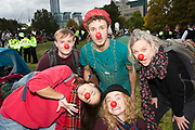 Clowning as protest as  Vauxhall gardens is cleared of Extinction Rebellion supporters on the 15th of October 2019 following a controversial issue of a Section 14 notice, declaring it illegal for them to protest in London, United Kingdom. <br /> <br /> Extinction Rebellion, who are seeking a judicial review of the ban, has pledged to cause two weeks of disruption in London and more than 60 cities around the world in an 'October Rebellion'. It is demanding that more be done to tackle climate change and force politicians and the media 'tell the truth' about global warming.
