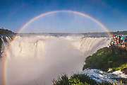 Natural wonders, getting up close to the Devil's Throat of the Iguazu Falls with this glorious rainbow from the spray rising off the waterfalls, part of the 2.7km long collection of waterfalls. This great view from the Argentine side of the Iguazu river.About half of the river's flow falls into a long and narrow chasm called the Devil's Throat (Garganta del Diablo in Spanish or Garganta do Diabo in Portuguese).
