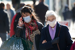 © Licensed to London News Pictures 21/10/2021.<br /> Bromley, UK, Some people are wearing masks as they shop in Bromley High Street, South East London. The coronavirus infection rate continues to rise as the Health Secretary Sajid Javid warning that cases could hit 100,000 a day in the winter months. Photo credit:Grant Falvey/LNP