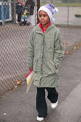 Young girl walking to school,