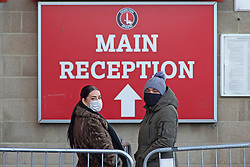 © Licensed to London News Pictures 03/01/2021.        Charlton, UK. Two masked students waiting in the queue. A Coronavirus testing centre has been set up by Greenwich Council at Charlton Athletic's football stadium in South East London to rapid test secondary school students and staff. <br /> The rapid test should give results in 30 minutes. Photo credit:Grant Falvey/LNP