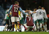 Villa park , Aston Villa v Rapid Vienna, Europa League Qualifier Leg 2 26/08/2010<br /> Ashley Young of Aston Villa is consoled in front of the jubilant Vienna players by Mark Albrighton<br /> Photo Marc Atkins  Fotosports International