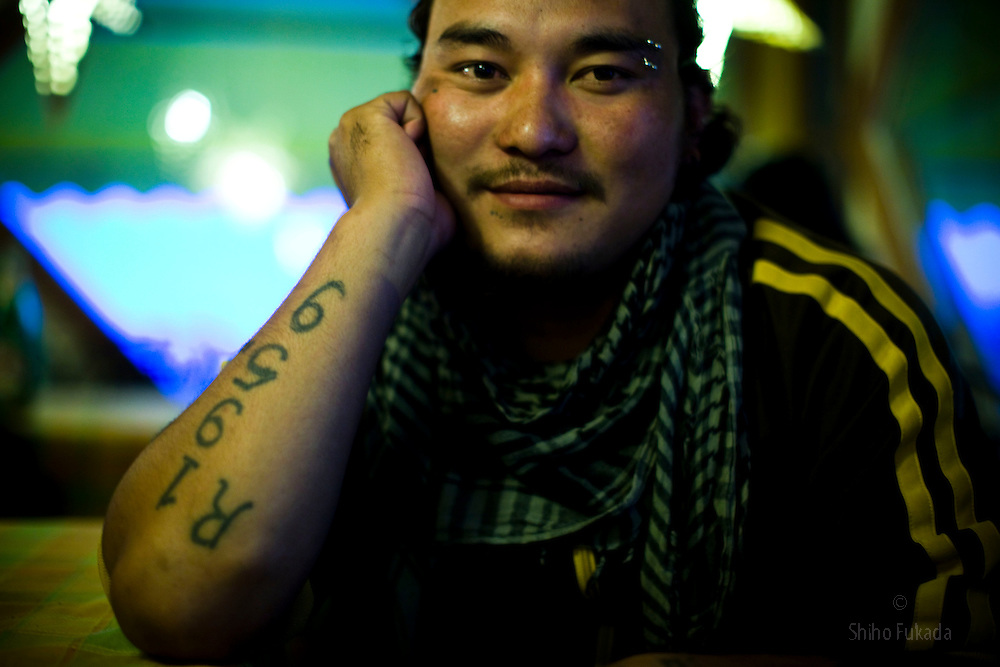 """A second generation Tibetan exile who was born in India and has never been to Tibet shows his tatoo with """"1959"""", a yaer of  Dalai Lama's exile from Tibet to India after a failed uprising against Chinese rule in McLeod Ganj, Dharamsala, India, May 30, 2009."""