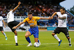 Calum Butcher of Mansfield Town holds off Derby County players - Mandatory by-line: Ryan Crockett/JMP - 18/07/2018 - FOOTBALL - One Call Stadium - Mansfield, England - Mansfield Town v Derby County - Pre-season friendly