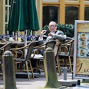 NLD/Laren/20130508 - John de Mol Sr. geniet van de lentezon op een terras in zijn woonplaats Laren NH,