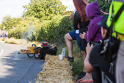 Cookham Dean, UK. 1 September, 2019. A custom-built kart in the form of Chitty Chitty Bang Bang runs into trouble during the Cookham Dean Gravity Grand Prix in aid of the Thames Valley and Chiltern Air Ambulance.