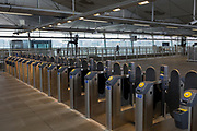 As the Coronavirus pandemic spreads across the UK, businesses and entertainment venues not already closed with the threat of job losses, struggle to stay open with growing rumours of a lockdown and travel restrictions around the capital. Londoners start to work from home leading to quiet platform barriers at Blackfriars railway station, on 19th March 2020, in London, England.