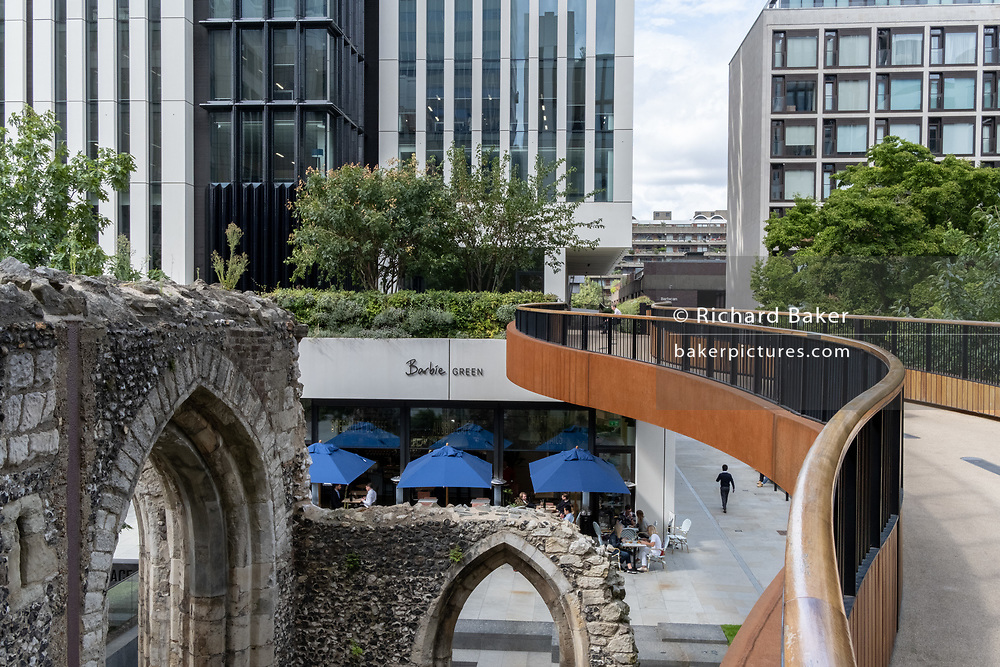 The ruined arches of St Alphage church and the modernist walkway above London Wall in the City of London, on 4th September 2020, in London, England. The earliest mention of St. Alphage goes back to the 1100s but was closed by act of Parliament in the late 1500s, one of the many victims of the dissolution of the monasteries - then damaged further in the Blitz.